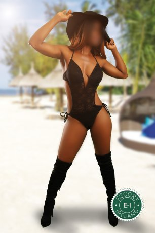 Carly is a hot and horny Caribbean Escort from
